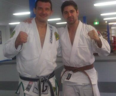 BJJ grading - Anthony Perosh presenting Bren Foster with his brown belt